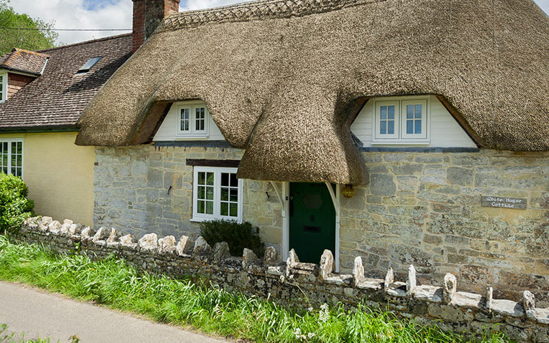 Flush sash windows on a thatched cottage